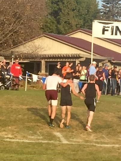 Habár Davis County High School senior Zachary Hougland, in white, finished first in an Oct. 22 cross-country race, he was disqualified after he'd helped a struggling opponent across the finish line.