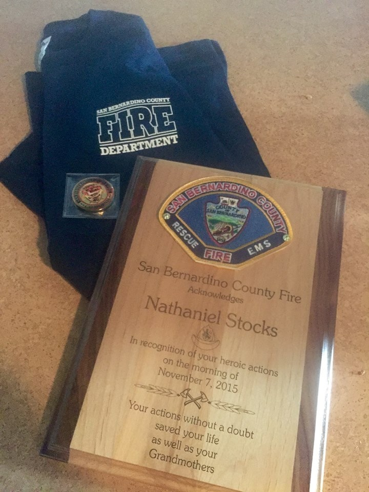 Nathaniel Stocks was honored by his local fire department after saving his grandmother's life during a fire