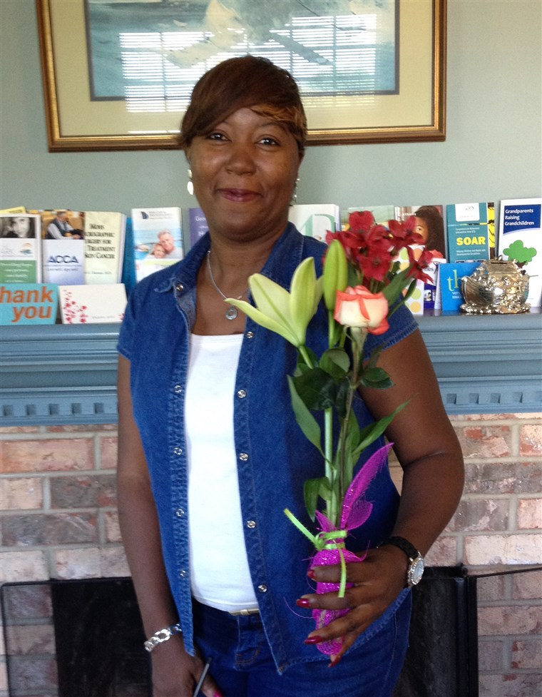 Juana Hulin with the Mother's Day bouquet from her Adopt-a-Mom sponsor.
