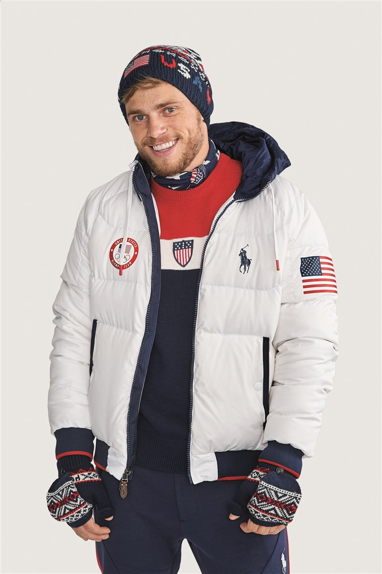 ओलिंपियन Gus Kenworthy models Team USA's official closing ceremony uniform for the 2018 Winter Games.