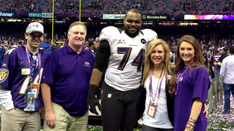 A Tuohy family celebrate together on the field after Michael's 2013 Super Bowl win with the Baltimore Ravens.