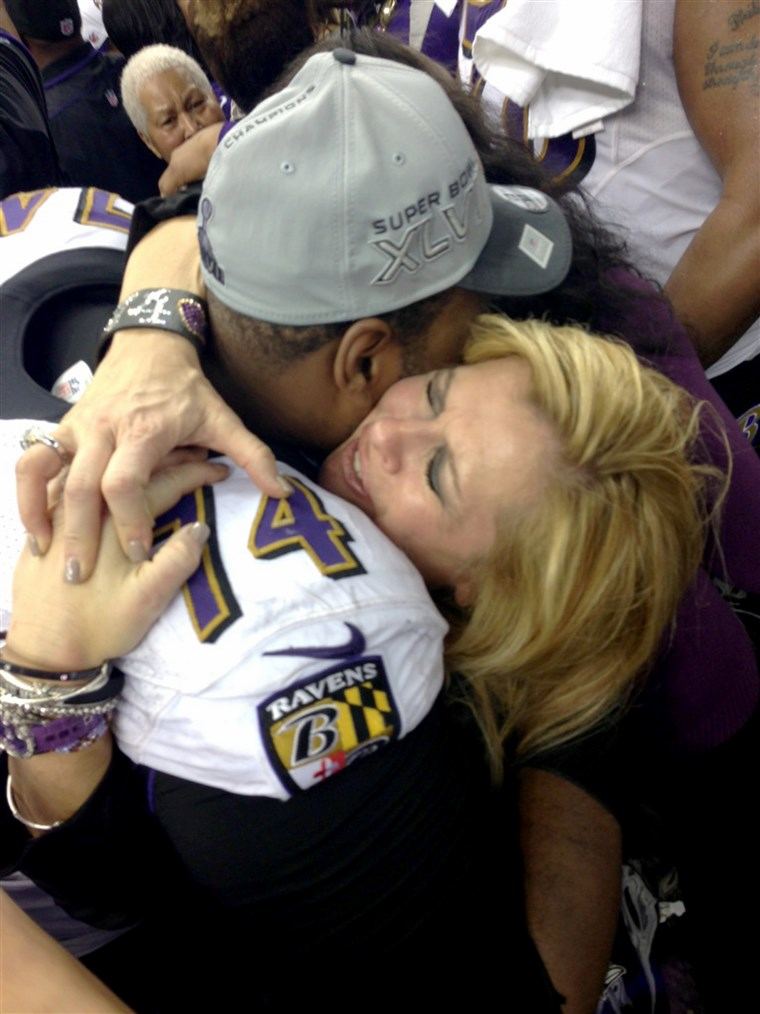 Tuohy hugs son Michael Oher after the Ravens 2013 Super Bowl win.