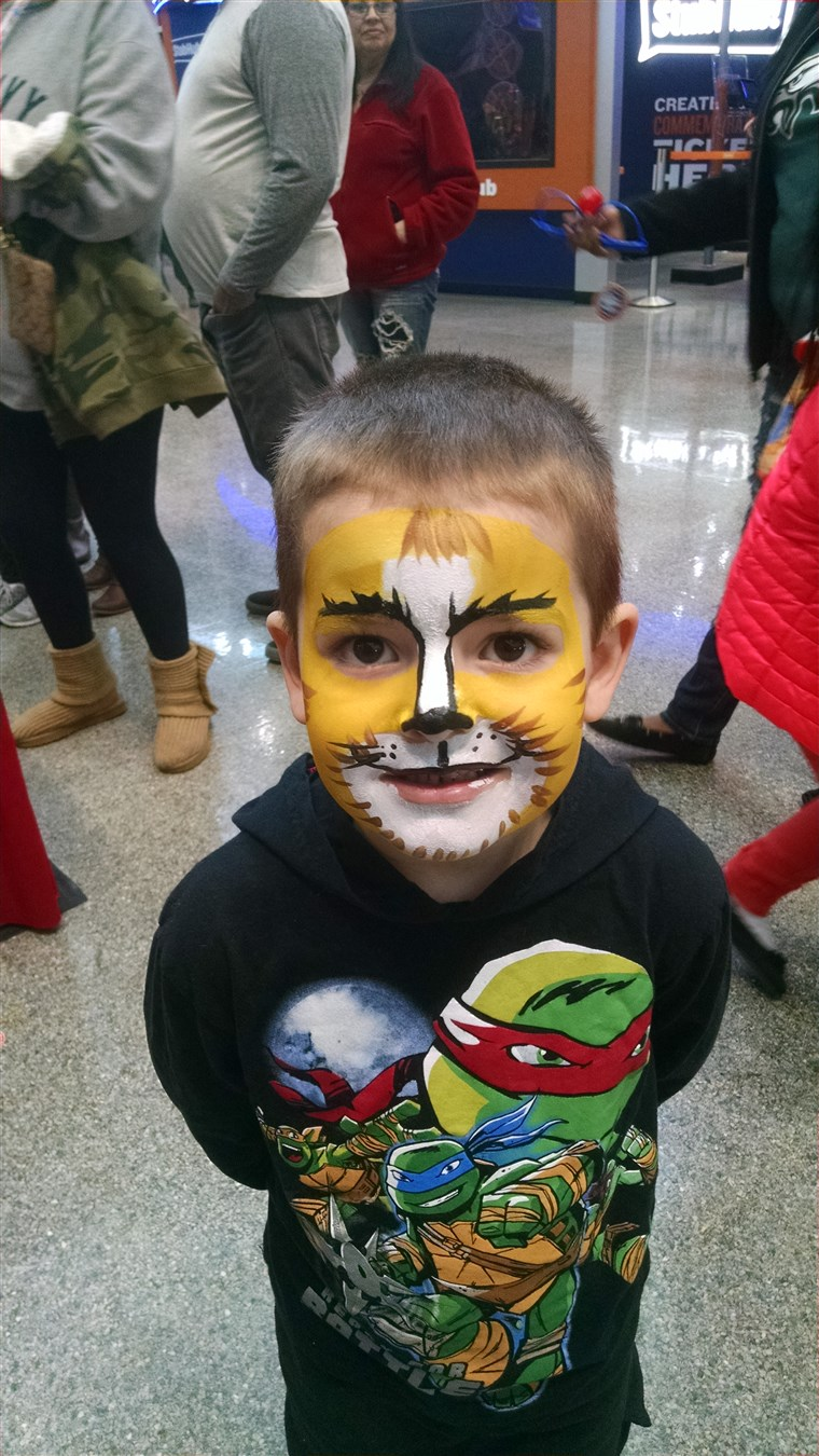 maksimum with his face painted at the circus.