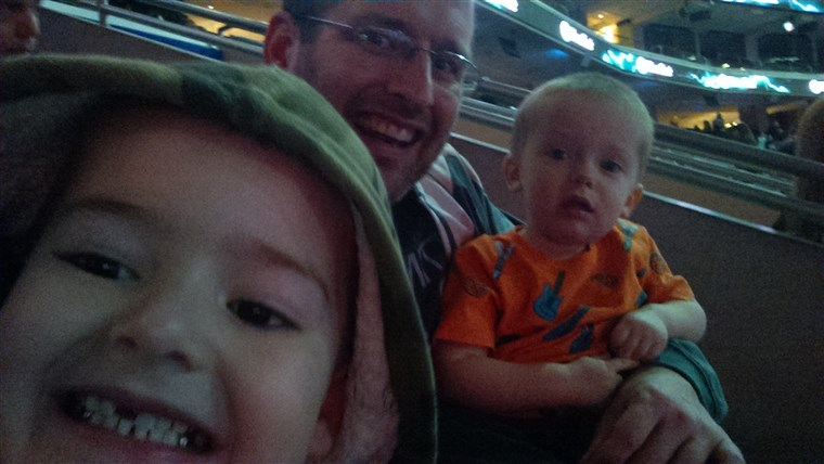 maksimum enjoying himself at the circus with his dad and brother.