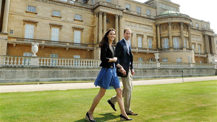 Britannia's Prince William and Duchess of Cambridge walk outside Buckingham Palace