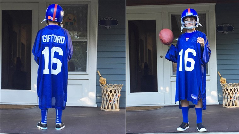 जोआन LaMarca's son, Mack, shows off the front and back of his Frank Gifford jersey.