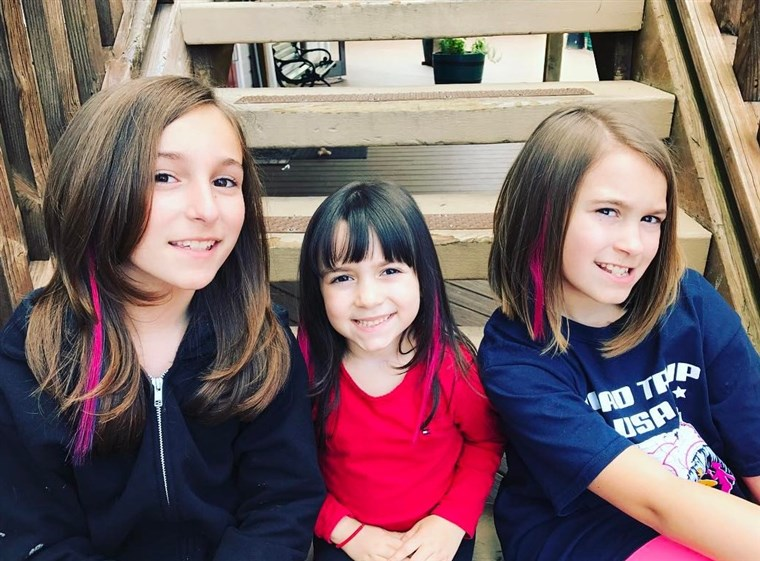 Nicole Sutton's daughters with their pink hair extensions.