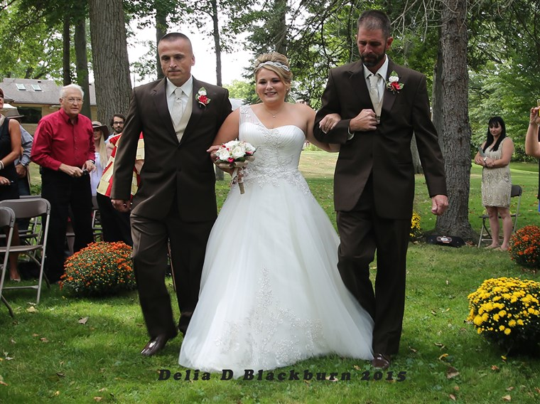 पिता and stepfather shared duties walking Brittany Peck down the aisle at her wedding