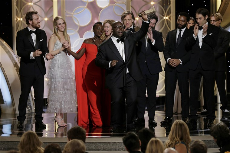 छवि: Steve McQueen celebrates after winning Best Motion Picture, Drama at the 71st annual Golden Globe Awards in Beverly Hills