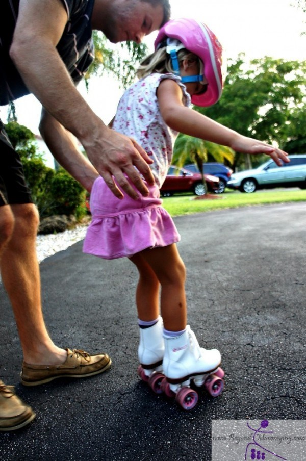 Tata helping daughter rollerskate