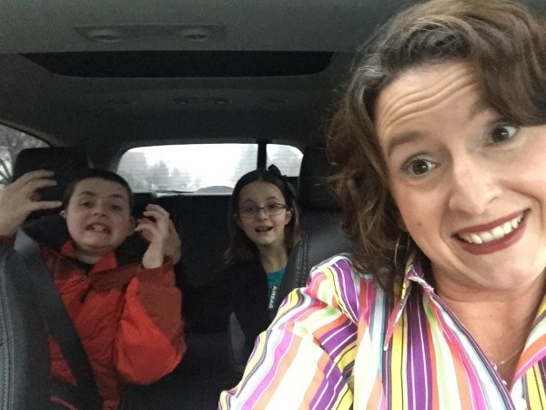 Mama Christine Burke in car with her kids
