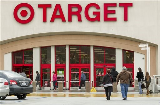 pers arrive at a Target store in Los Angeles on Thursday, Dec. 19, 2013. Target says that about 40 million credit and debit card accounts may have...
