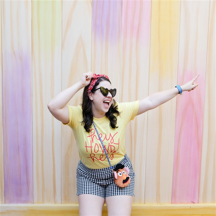 Nicole White poses with the Popsicle Stick Wall, found in Toy Story Land at Hollywood Studios.
