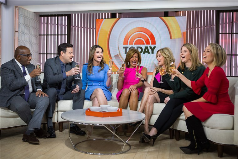 MA colleagues toast the new anchor!