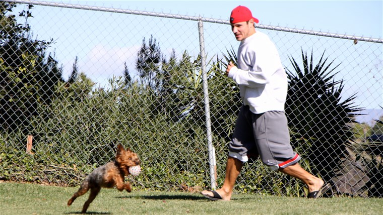 zarez Lachey plays outside with his dog, Wookie.