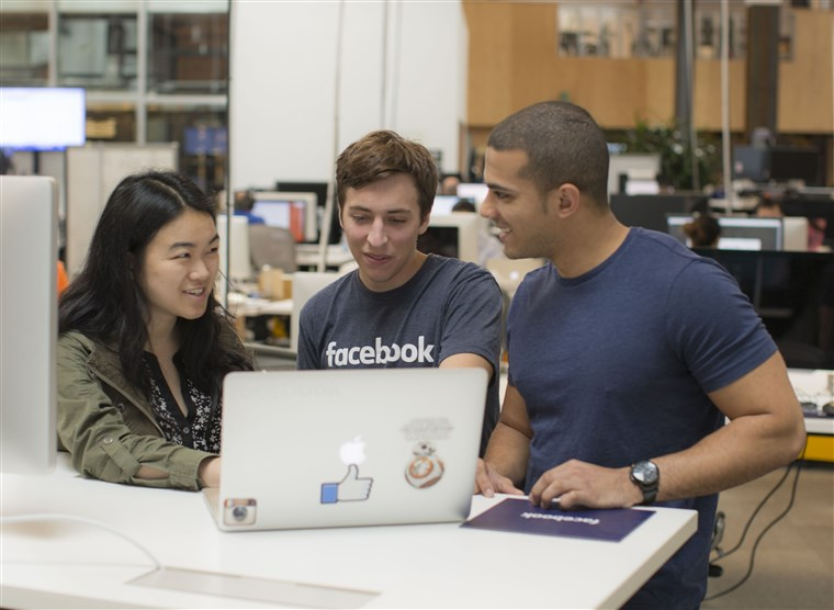 ए group of Facebook interns collaborate on a team project