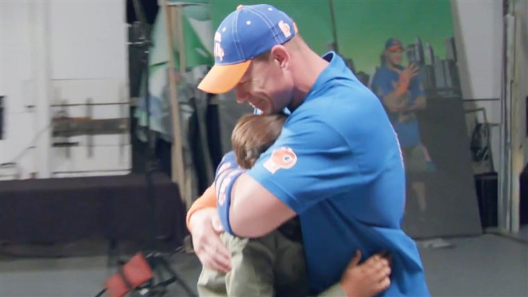 Ivan Cena reacts to being surprised by young fan Tyler Schweer.