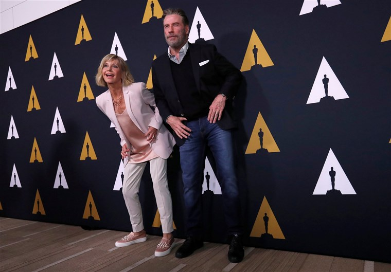 תמונה: Cast members Travolta and Newton-John dance at a 40th anniversary screening of