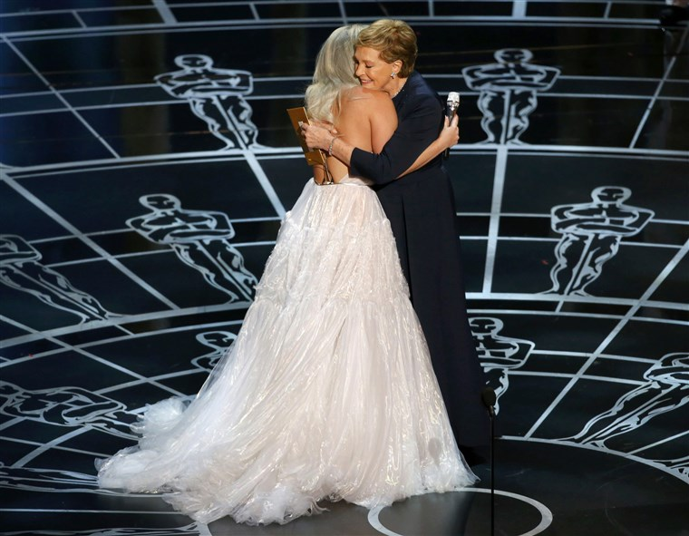 ג'ולי Andrews hugs Lady Gaga after she performed songs from the Sound of Music at the 87th Academy Awards in Hollywood, California