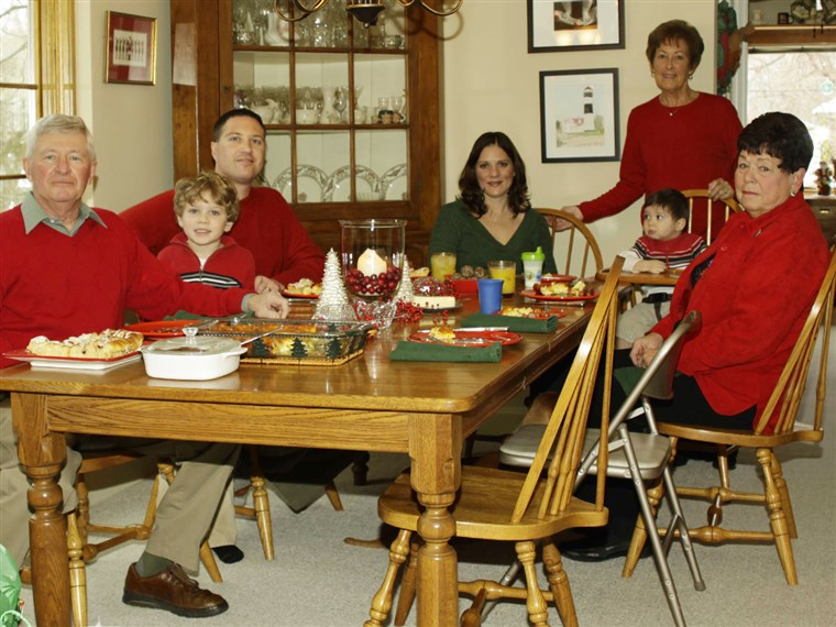 Parker family of Pontiac, Mich., is shown on Christmas Day 2010, minutes before the clear glass baking dish at the head of the table shattered into hundreds of shards, according to Debbie Parker. Parker, standing, said she found glass pieces three feet away under the Christmas tree.