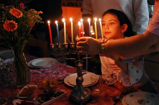 מה's that ninth candle on the menorah called? Ask the convert! (It's the shamash, FYI.)