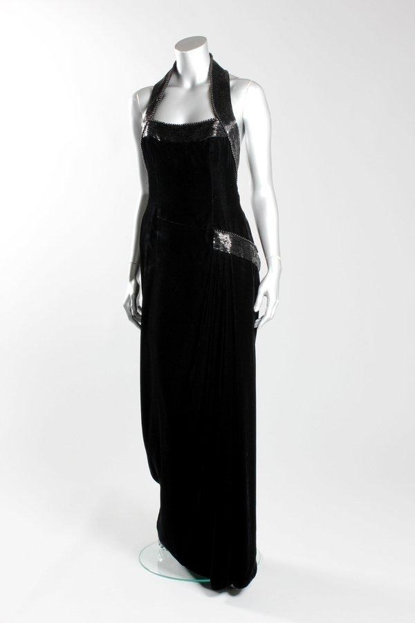 Diana wore this Catherine Walker black velvet and beaded evening gown for the Vanity Fair photo-shoot at Kensington Palace in 1997. It sold Tuesday for $163,000.