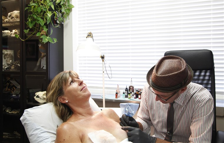 Bradavica tattoo artist Vinnie Myers works on client