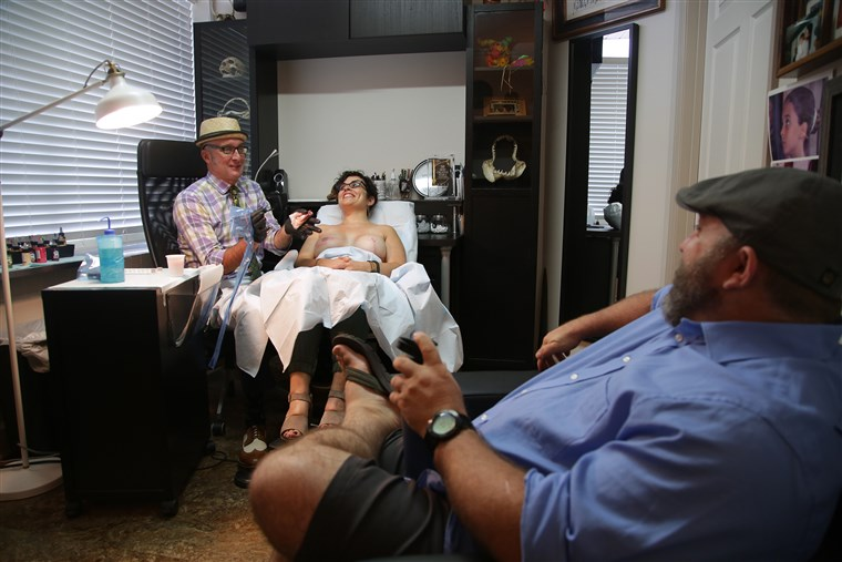 Bradavica tattoo artist Vinnie Myers works on a client