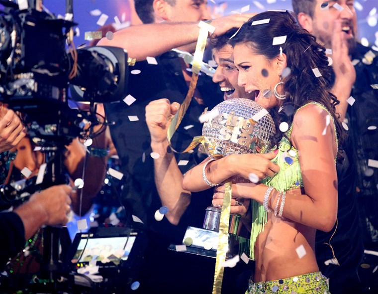 Méhfű Rycroft and pro partner Tony Dovolani hold the mirror ball trophy as they are crowned champions on the season finale of ABC's