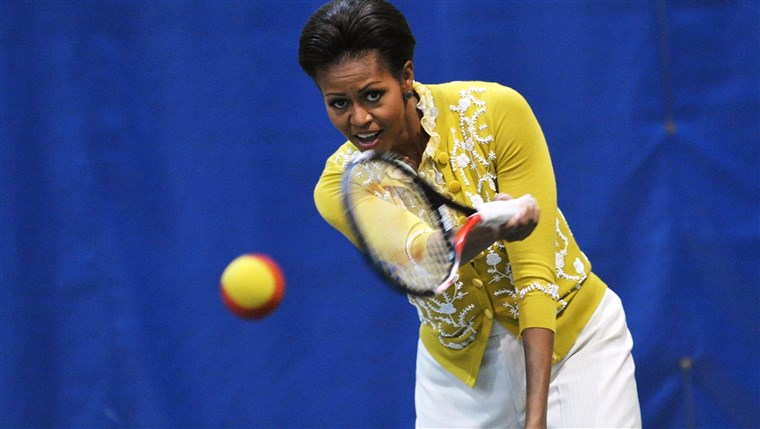 MINKET First Lady Michelle Obama plays tennis while attending a mini-Olympics event with local school children at American University's Bender Arena March...