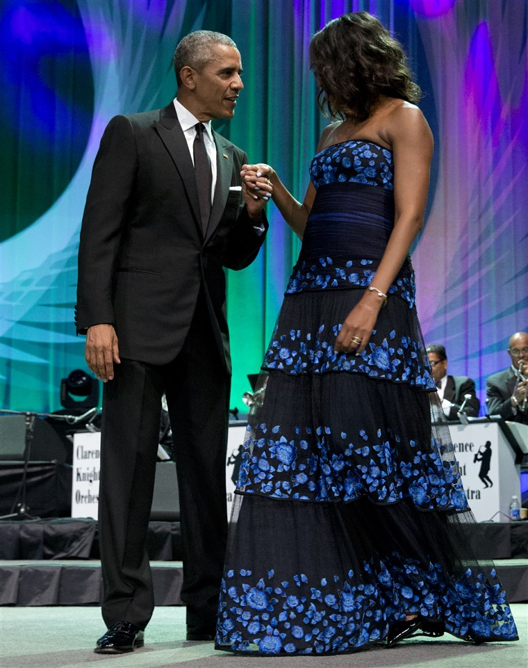 photo of President Obama holding the hand of Michelle Obama