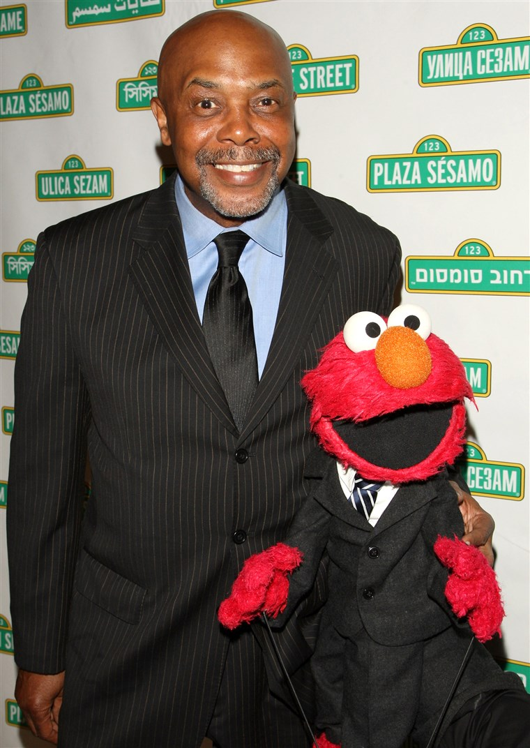 Roscoe Orman poses with Elmo