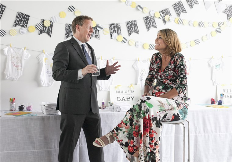 cute couple: Mike Feldman says a few words at wife Savannah Guthrie's baby shower.