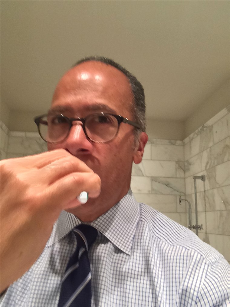 Lester Holt brushes his teeth.