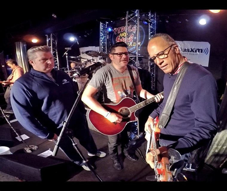 MA's Lester Holt plays bass at The Rascal Flatts' performance at the Fiddle and Steel Guitar Bar in Nashville.
