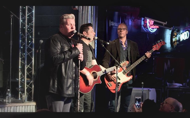 MA's Lester Holt joins The Rascal Flatts on stage at the Diffle and Steel Guitar Grill in Nashville.