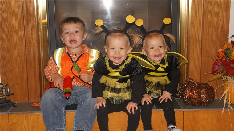 girls with their big brother, Jaxon, 3, on Halloween.