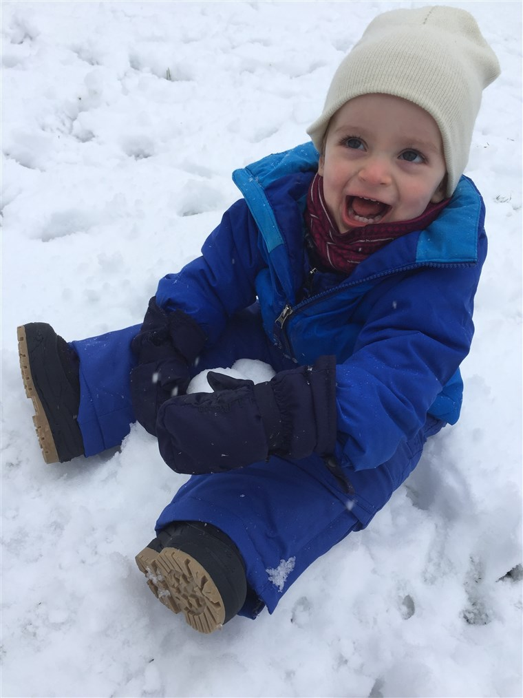 Hladno? Snow? Who cares? Theo shows his love for the outdoors with lots of laughs and smiles.