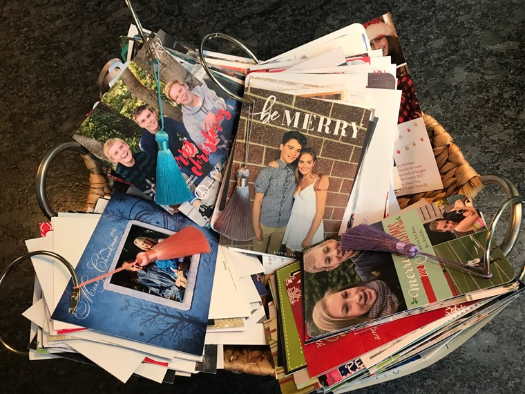 Ne only are they festive and a great way to stay organized, Holiday Card Rings also provide a perfect way to divert awkward conversations during the family holiday party. Just look at old cards!