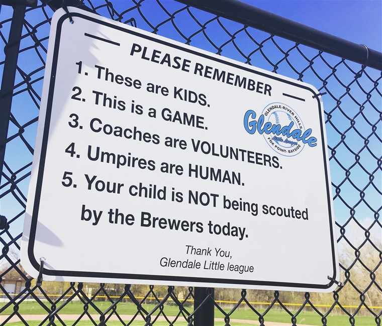 ए sign reminding parents that baseball is just a game hangs in several fields where Glendale Little League plays.