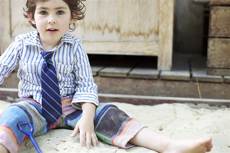 थोड़ा gentleman: A boy featured on Ladys & Gents wears a shirt and shorts by Trico Field, tie by Janie & Jack.