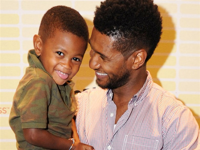 אשר and his son, Usher Raymond V, attend a conference for the singer's foundation in Atlanta on July 21.