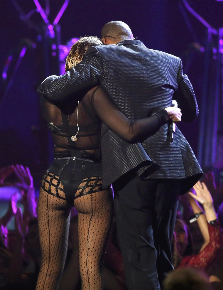 Beyonce and Jay-Z hug as they walk offstage after performing