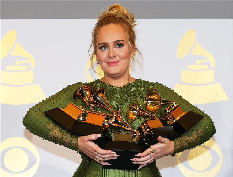 Adele holds her five Grammys during the 59th Annual Grammy Awards in Los Angeles