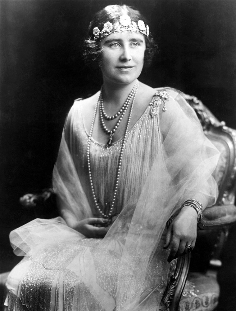 A Queen Mother wore the Strathmore Rose tiara low around forehead in true '20s flapper style.