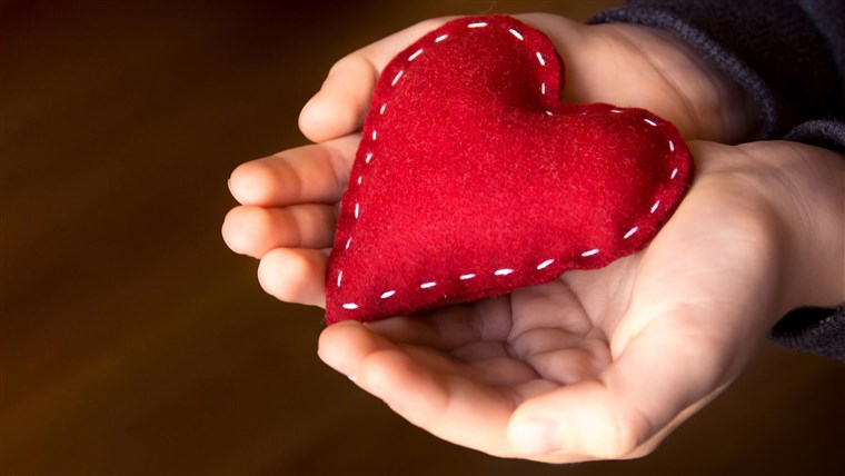 Piros heart in child hands, hand made gift, valentine day and family love concept, close up, horizontal